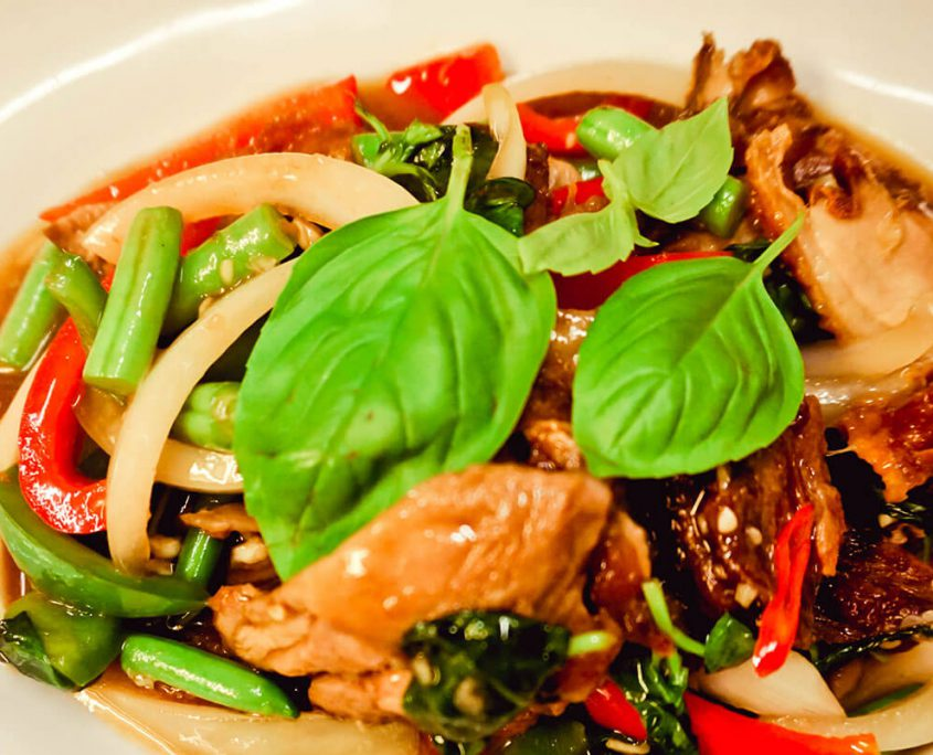 Stir fried duck with basil