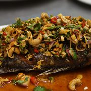 deep fried fish topped with thai herbs